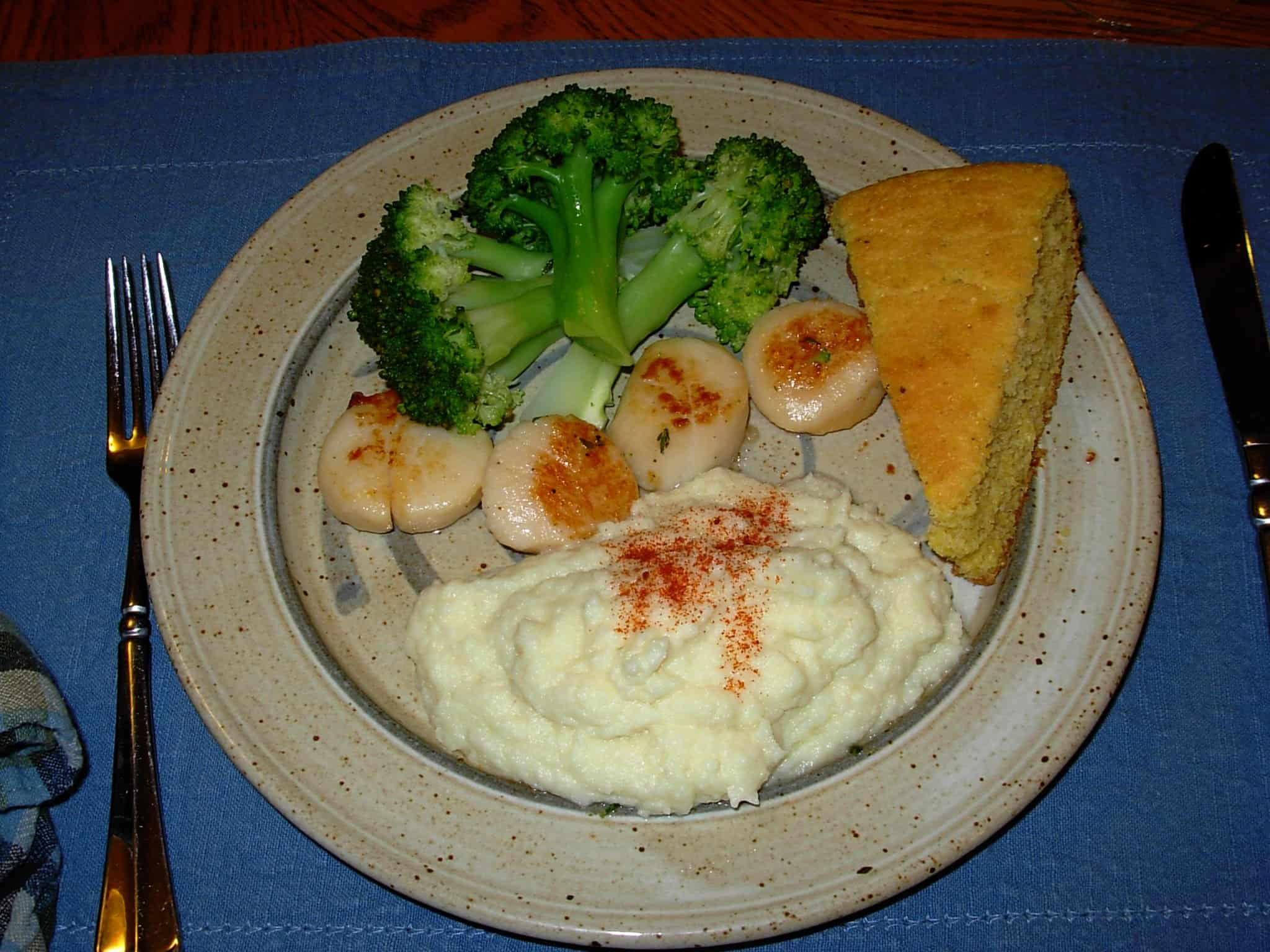 Scallops, broccoli, mashed cauliflower, cornbread
