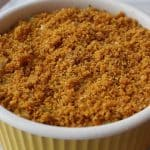 Parmesan Squash Casserole is topped with breadcrumbs.