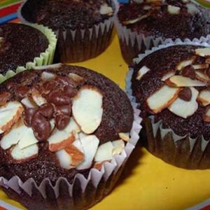 Gluten Free Chocolate Cupcakes with sliced almonds and chocolate chips