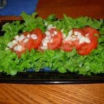 Bitter leaf lettuce, tomato and onions is a good combination for Vinegar Dressing