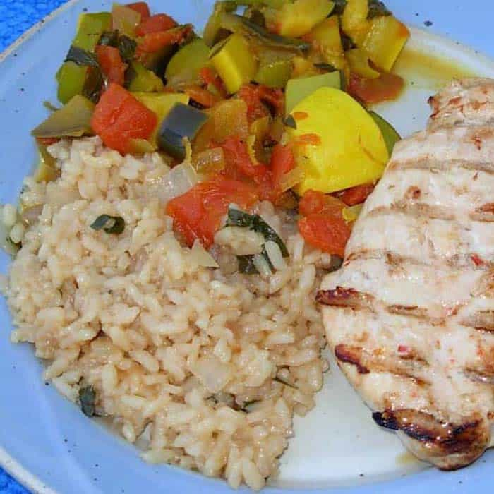 This recipe tells you how to make risotto, shown here with Italian Chicken and Indian Ratatouille.