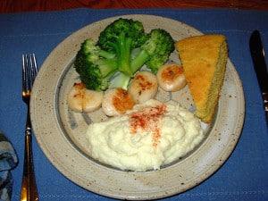 Serve Sautéed Scallops with Cauliflower Surprise, Steamed Broccoli and Cornbread.