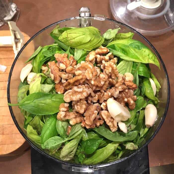 Easy peasy. Chop up basil, garlic and walnuts together.