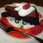 Homemade Raspberry Sauce adds a depth of flavor to chocolate cake.