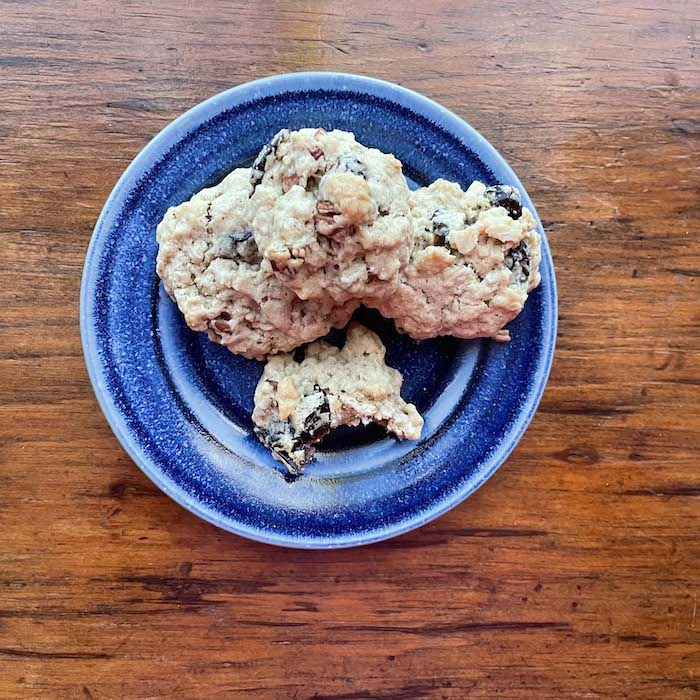 """Oatmeal Craisin Pecan Cookies. Easy and quick. Shown on a plate by <a href=""""https://quailrunpottery.com"""" target=""""_blank"""" rel=""""noopener""""><span style=""""text-decoration: underline;""""><strong>Elizabeth Krome, potter</strong></span></a>."""