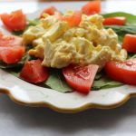 Egg Salad is tasty alone, over greens, on a sandwich or stuffed in a tomato.