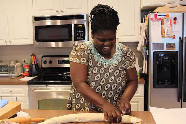 Roll out the dough until it is thin. Spread about one teaspoon of oil over it. Sprinkle with flour, and roll up.