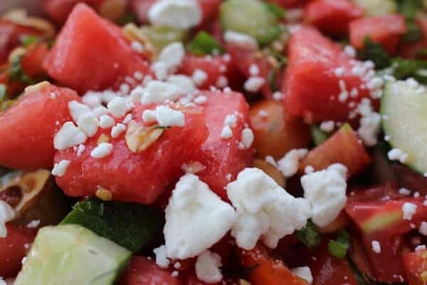 Watermelon Cucumber Mint Salad with Tomatoes and Feta. Light and refreshing. Surprisingly filling. Delightful! #watermeloncucumbermintsalad, #watermelonfetamintsalad, #watermelontomatofetasalad, #watermelonmint