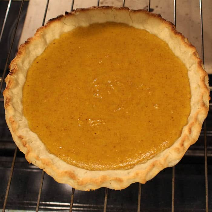 Pumpkin Pie—the edges are brown enough now. But it needs more baking!