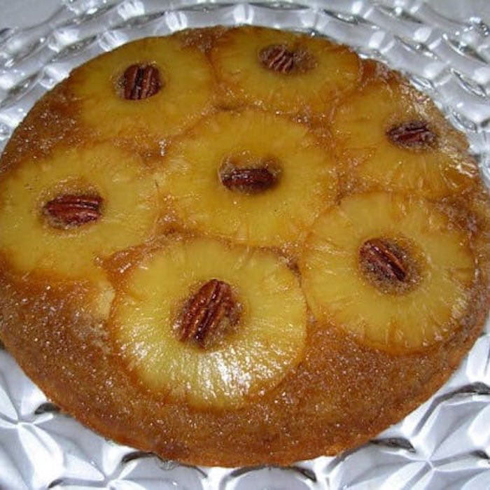 Pineapple Upside Down Cake can use pecans or Maraschino cherries as a garnish.