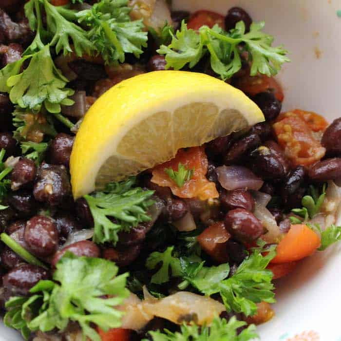 Middle Eastern Black Bean Ful, only the most flavorful bean dish you can eat. Top it with Tomato Basil Chutney for an even more delicious meal.