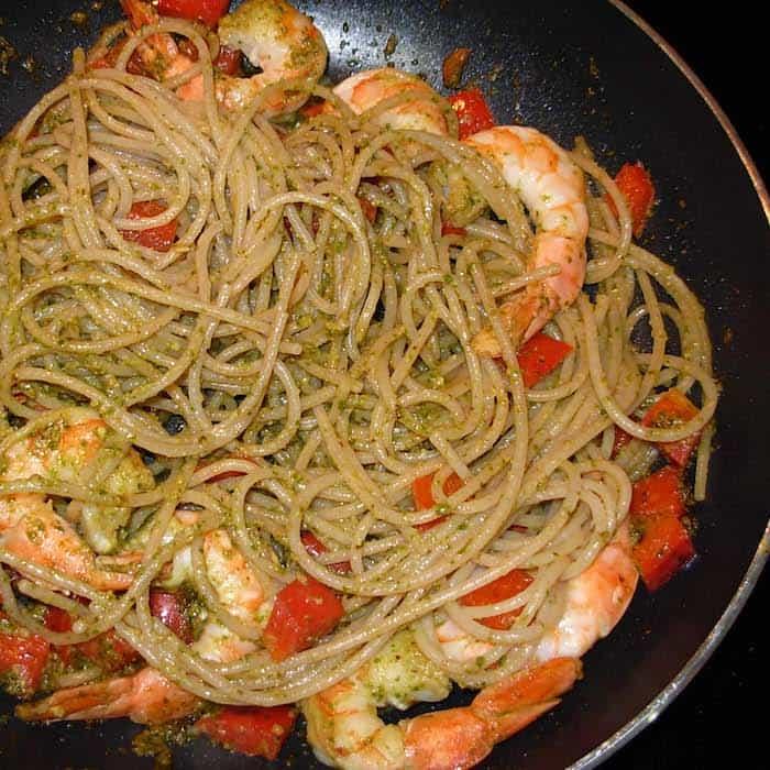 Basil pesto, pasta, shrimp, a little red bell pepper. Yum.