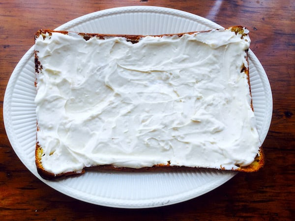 Spread the pudding-whipped cream mixture over the bottom portion of the pastry.