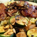 Caramelizing the onions in this Zucchini Onions Almonds side dish is the key to flavor.