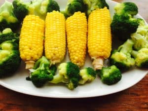 Corn, broccoli and a side of tomatoes for supper.