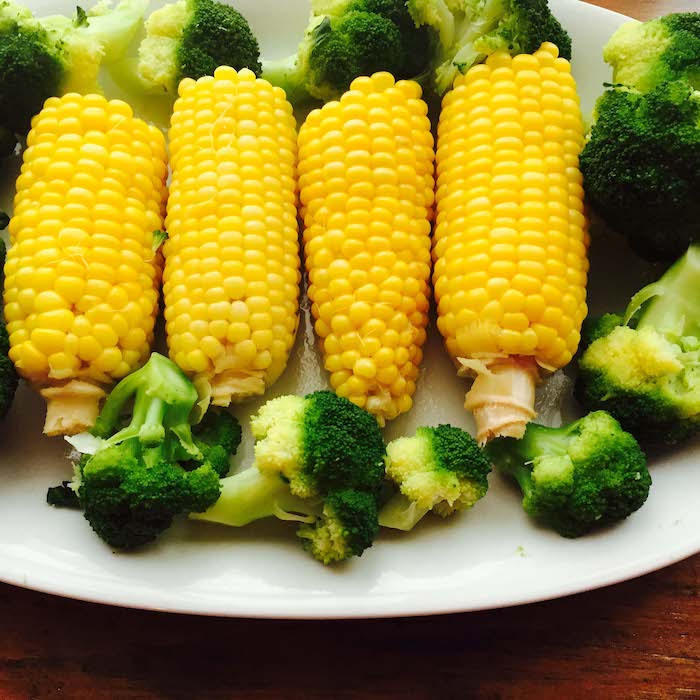 Fresh boiled corn and steamed broccoli make a scrumptious meal.