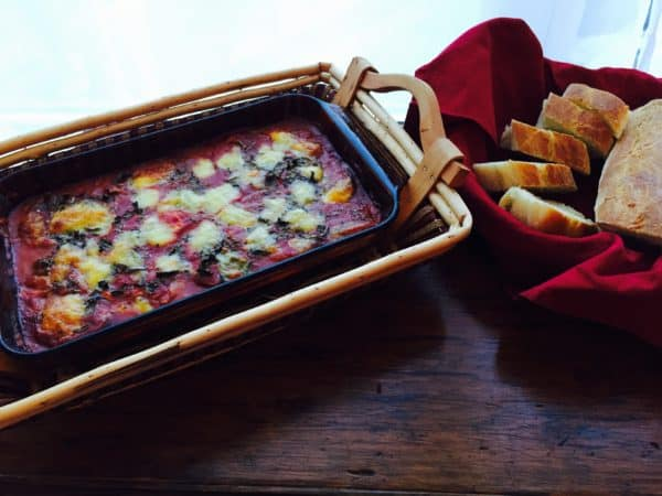 3 Cheese Vegetarian Eggplant Parmesan is baked in an oblong pan.