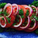 This simple sliced tomato onion salad has a light vinaigrette that is perfect for summer.