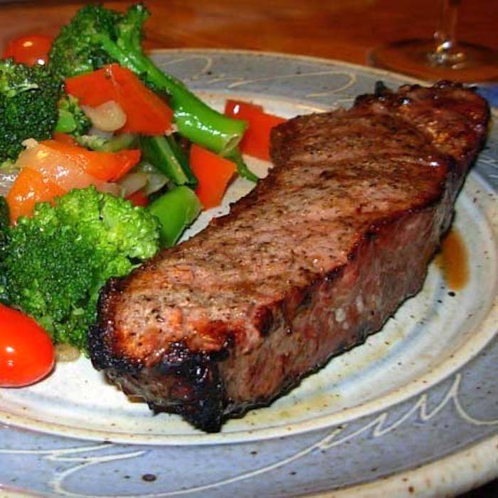 A NY Strip Steak (or any steak) is easy to cook at home.