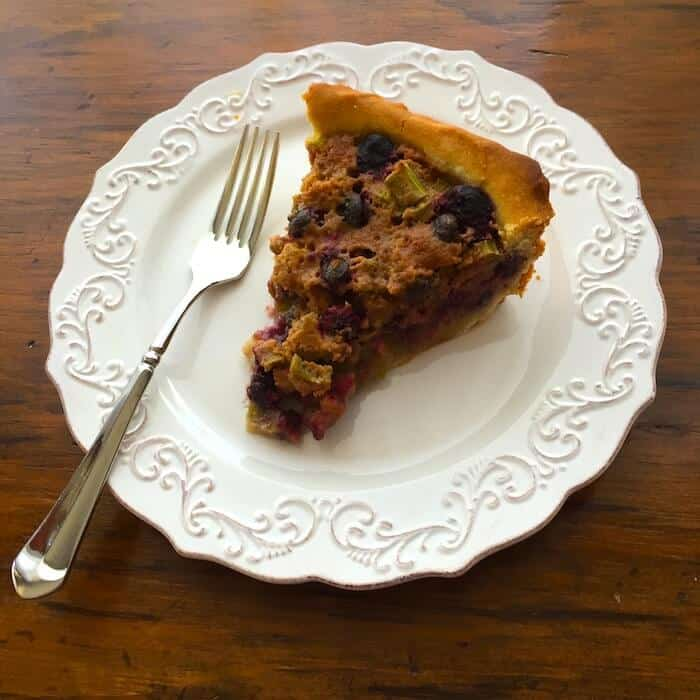 A slice of Gluten Free Blueberry Rhubarb Pie is so tasty.