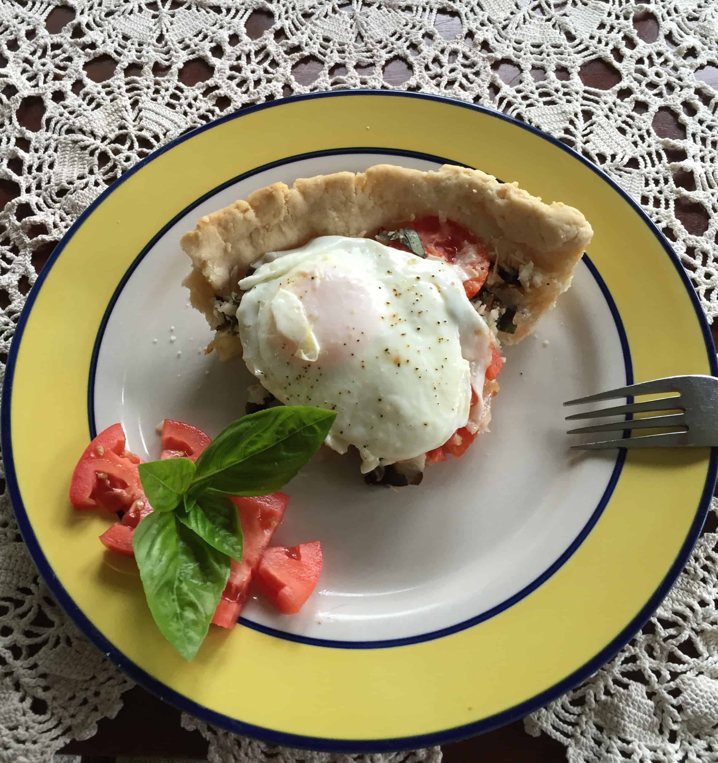 Gluten Free Tomato Basil Breakfast Tart with a Fried Egg on Top