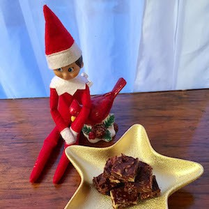 El Cocinero, the naughty elf, pretends he's not about to take a bite out of that amazing fudge!