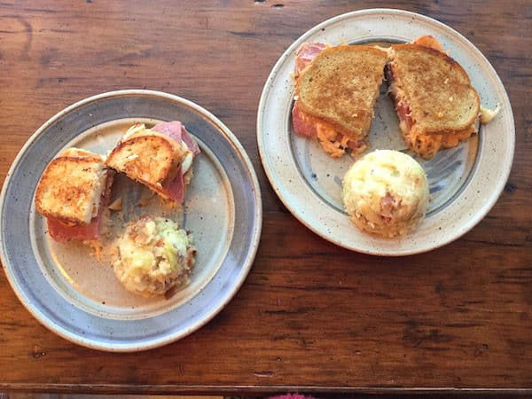Two kinds of Reubens: Gluten Free Halloumi Corned Beef Reuben (left) and Classic Corned Beef Reuben (right).