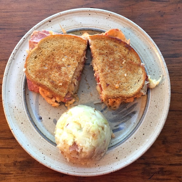 Classic Corned Beef Reuben Sandwich on Rye, shown with Colcannon. Great Irish meal.