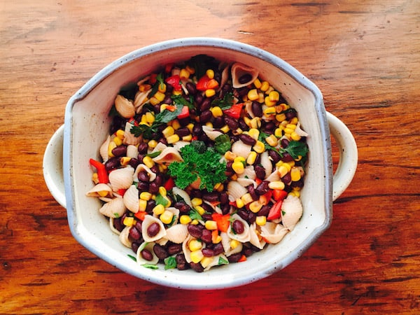 Black Bean Corn Pasta Salad, shown in an Elizabeth Krome handmade pot.