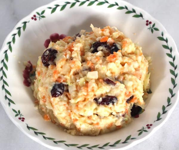 Craisin Coleslaw can be made with dried cranberries (craisins) or raisins.