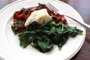 Sautéed Spinach shown with Cod and Tomato Basil Chutney