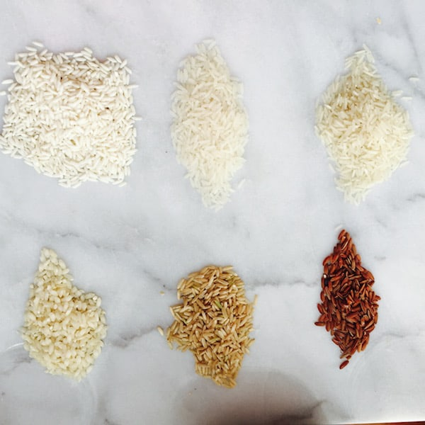 Top Row: Sticky Rice, Jasmine Rice, Basmati Rice. Bottom Row: Arborio Rice, Brown Rice, Red Rice.