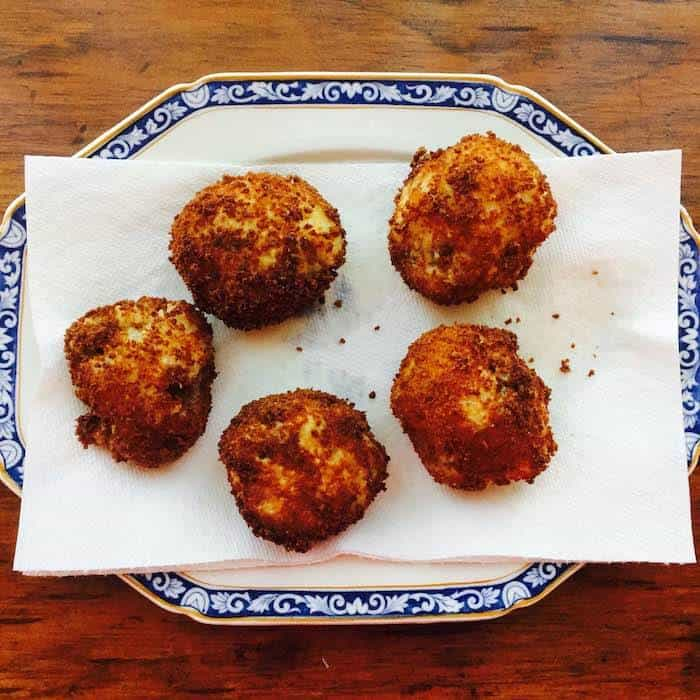Crispy Sausage Rice Balls are tasty alone, or in red sauce.