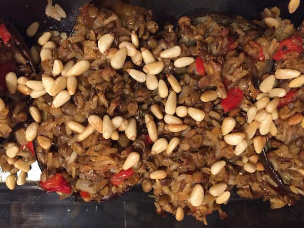 Lentil Rice Stuffed Eggplant topped with Pine Nuts