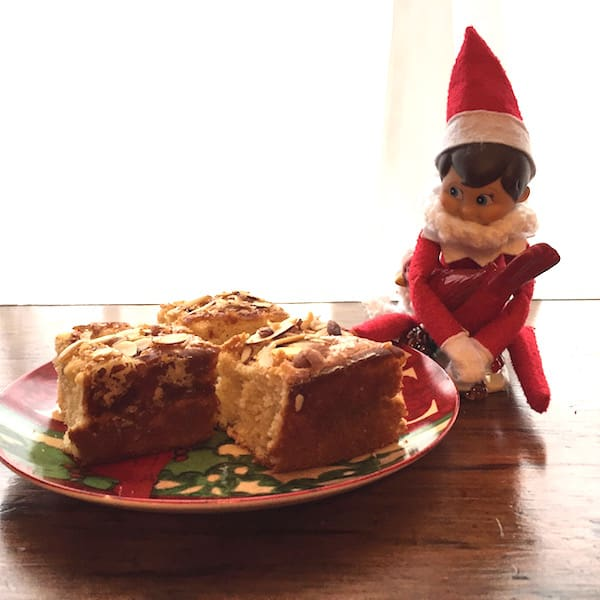 The elf is eyeing the Gluten Free Cinnamon Almond Coffee Cake!