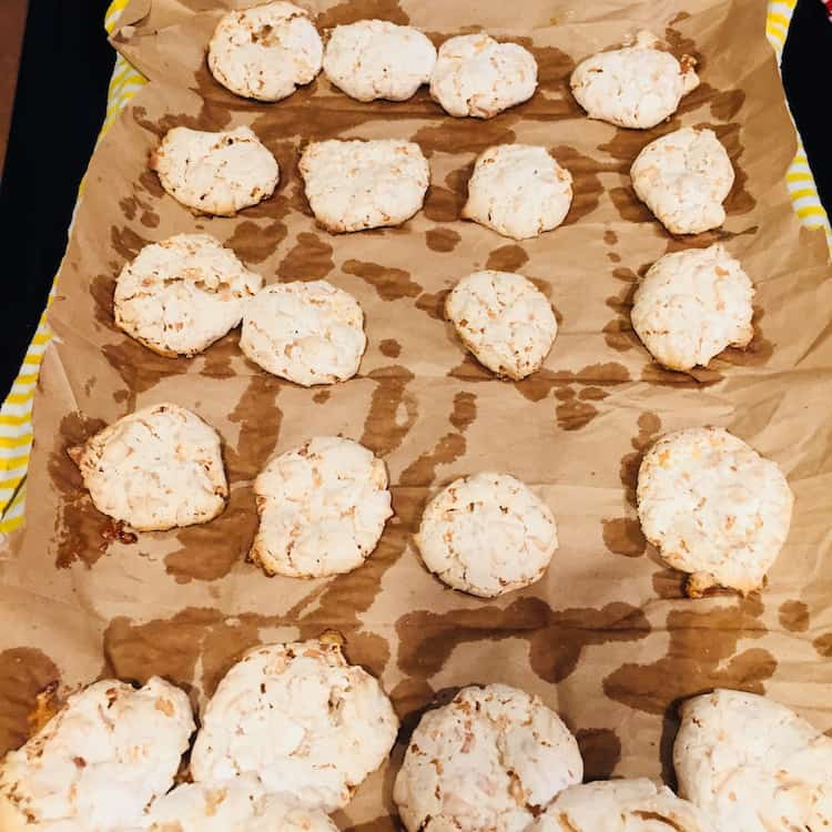 See how the moisture comes through? Coconut Kiss Cookies baked on brown paper and then placed over a wet towel make it easy to remove them.
