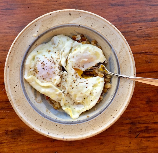 Green Lentil Quinoa Salad, topped with two eggs. Yum!