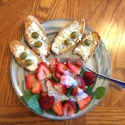 Simple Strawberry Spinach Salad Recipe with Brianna's Poppyseed Dressing, shown with Gluten Free Dairy Free White Bread, goat cheese and olives. Add a glass of wine for a lovely lunch. #strawberryspinachsalad #simplestrawberryspinachsalad #sitdownandrelax