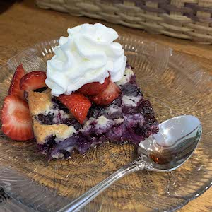 Blueberry Cobbler with Strawberries and Whipped Cream