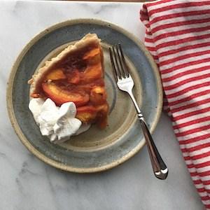 A slice of Fresh Peach Pie with Sweet Gluten Free Pie Crust