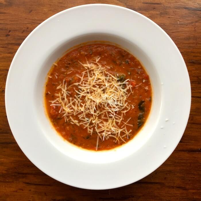 Roasted Tomato Basil Soup with a little Pecorino Romano sprinkled on the top. Yum!