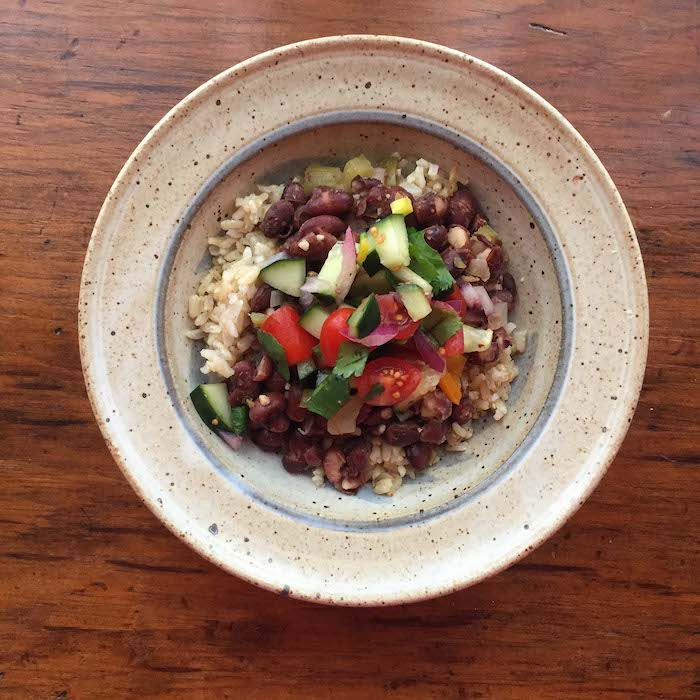 Louisiana Red Beans and Rice is very tasty topped with Cucumber Salsa. You won't care that it's vegan.