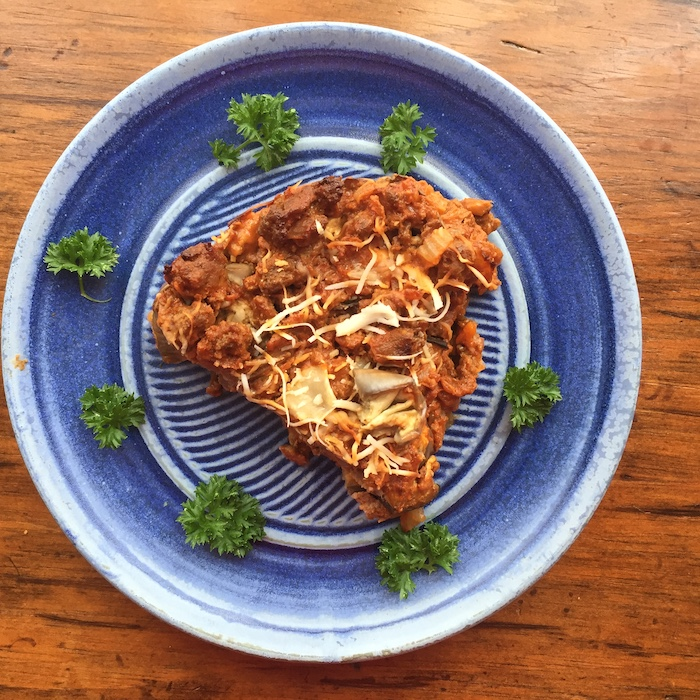 """Egyptian Eggplant is a simple layered """"lasagna"""" without noodles. Beautiful plate by Betsy Krome, Quail Run Pottery."""