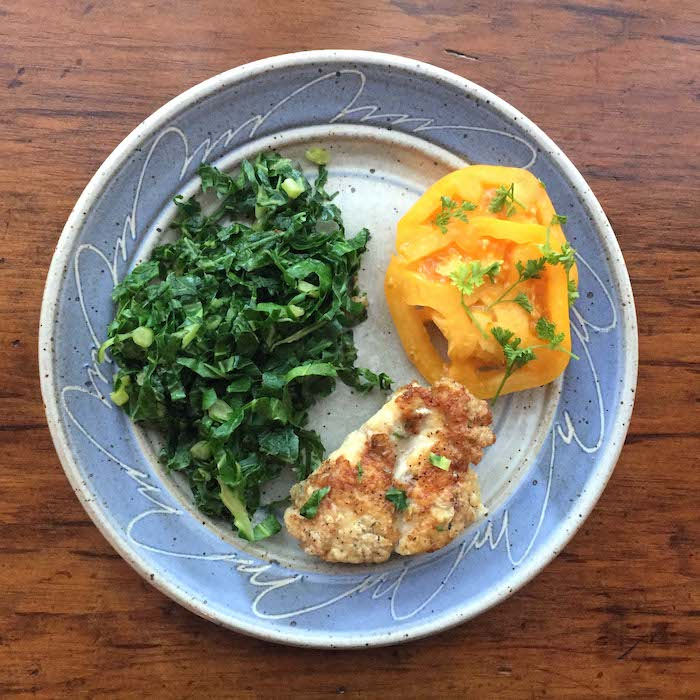 This chicken and collards recipe is low fat and full of flavor. Beautiful plate by Elizabeth Krome at Quail Run Pottery.