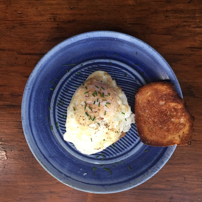 Now here's an amazing breakfast. Make a Stacked Cheesy Grits & Sausage by placing a cooked, hot sausage patty on a plate. Add 1/2 cup grits and one fried egg. Oh my! Absolutely delicious. (Beautiful plate by Elizabeth Krome, Quail Run Pottery.)