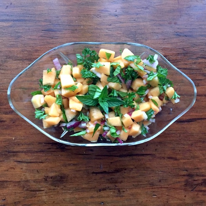 Cantaloupe Melon Relish with a light vinaigrette is perfect atop a bed of greens.
