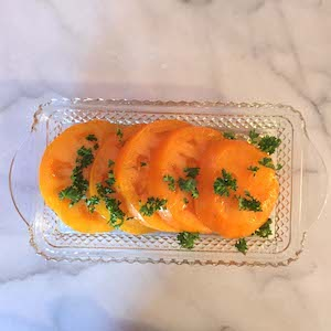 Homegrown Orange Sliced Tomatoes with Vinegar and Oil. Yum.