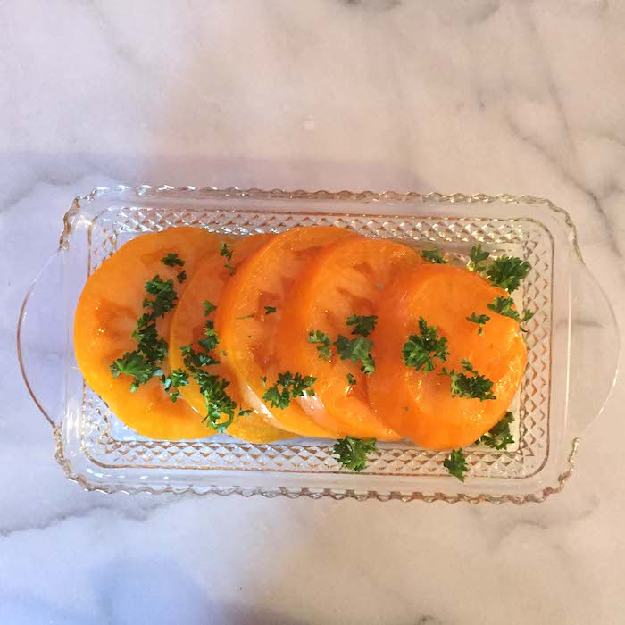 You can use whatever kind of tomato you have, red, orange, yellow or heirloom, in this Sliced Tomato Salad recipe.