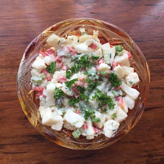 Pickle Potato Salad is creamy and a bit sweet.